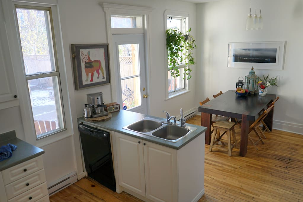 Bright, clean kitchen.  Back door opens up onto private, large backyard.