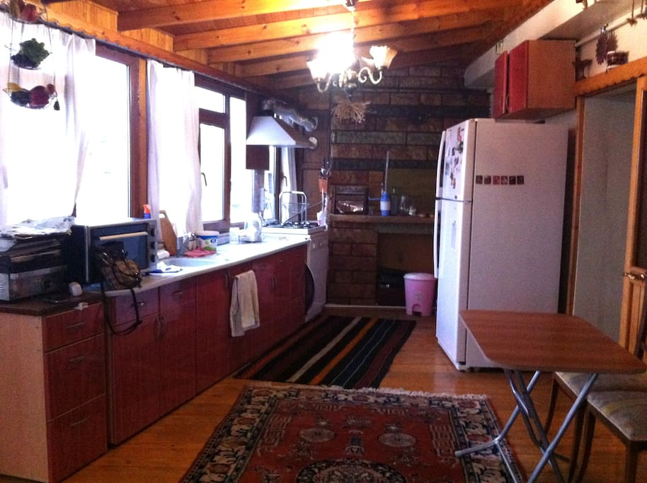 Saloon and kitchen is together but its not smell food. Ventilation is working and There is a fireplace-barbecue.