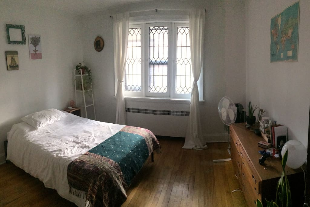 Bright bedroom with comfy double bed, drawers, large closet.