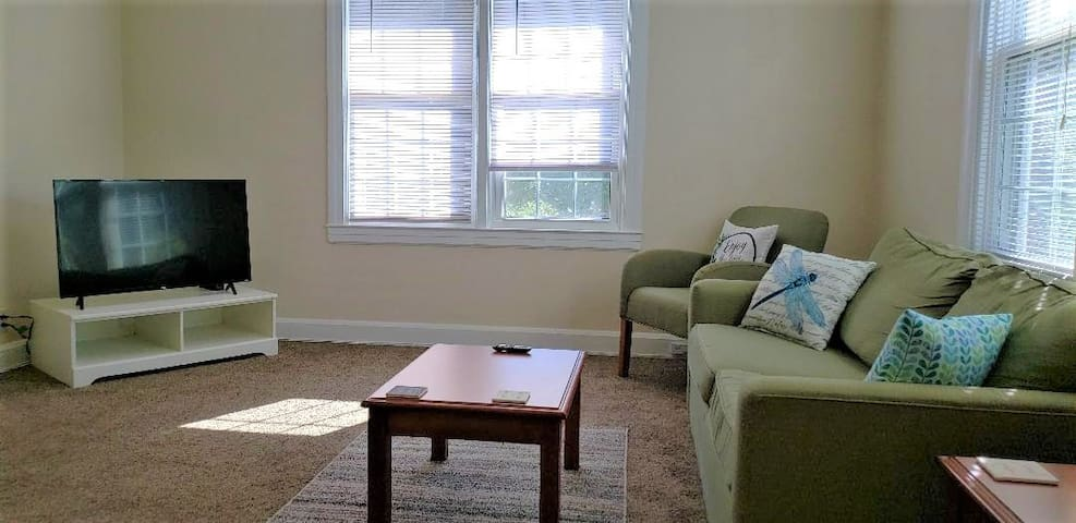 Comfortable sitting area with pull out couch. Lots of natural light from the surrounding windows.