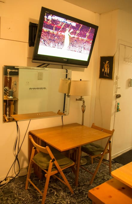 dining space with tv