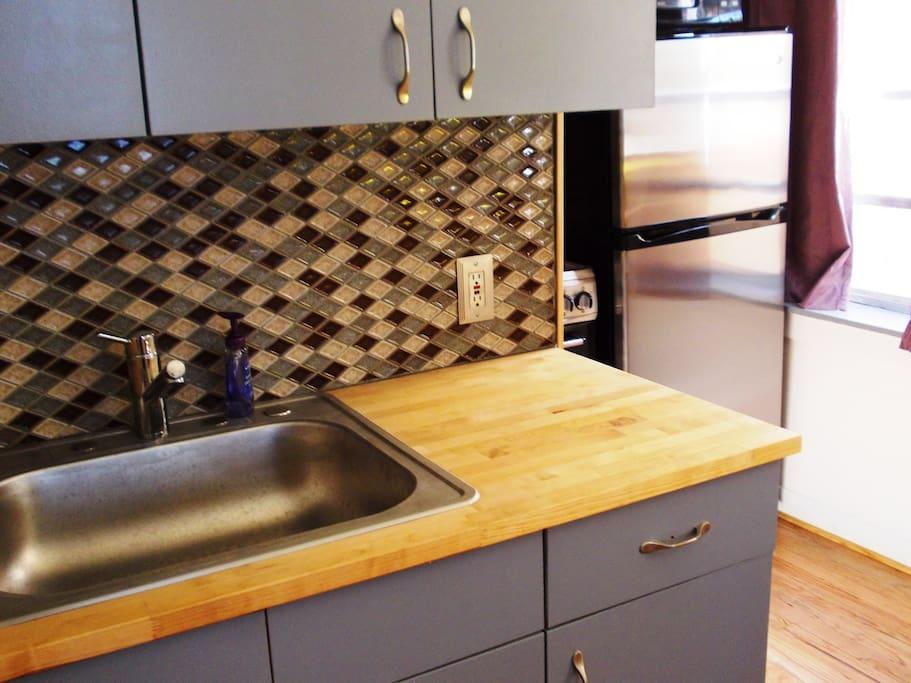 Sink,   Butcher Block Counter top, Tile Backsplash