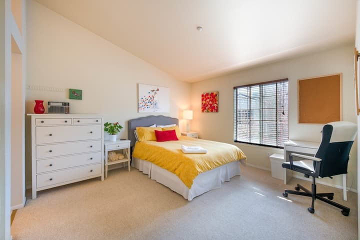 Cheerful master bedroom with private bath