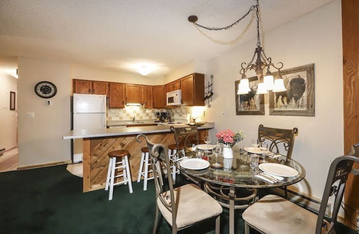 The condo has an open floor plan in the kitchen, dining and living areas.