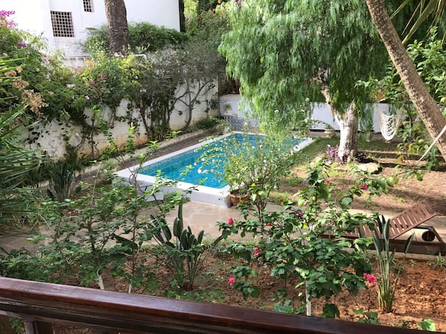Flat in a lovely villa with garden and heated pool