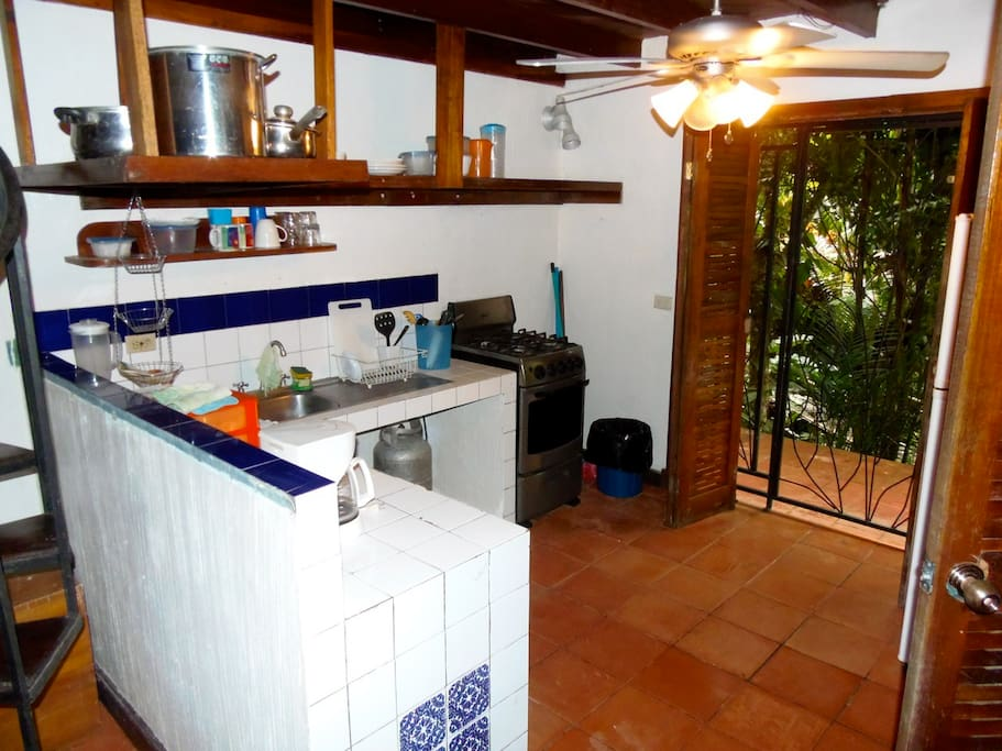 Fully equipped kitchen with a new stove and refrigerator.