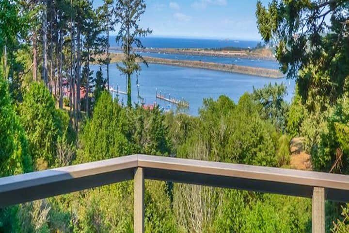 Charming coastal home w/ water views, large covered deck, & private gas grill!