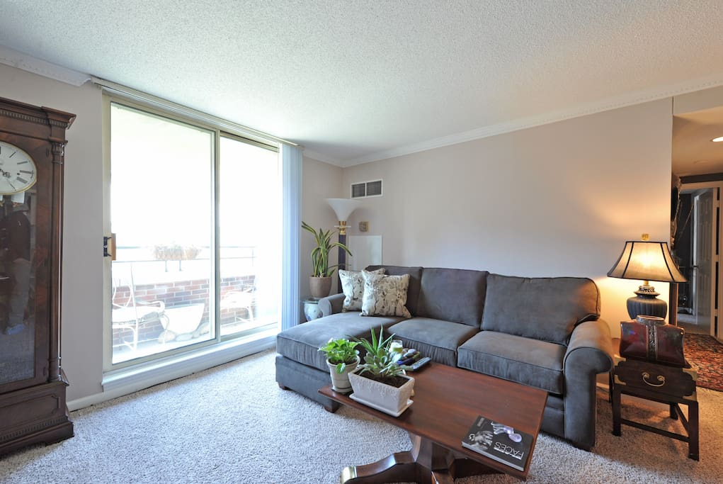 Living Room with a patio view of downtown Louisville