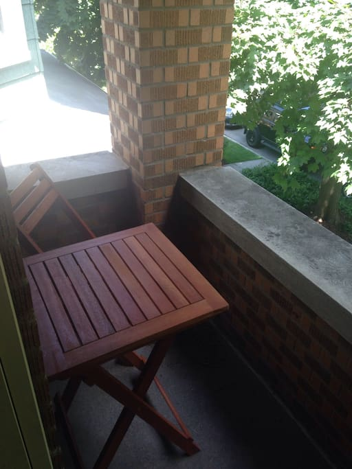 Small patio with table and two chairs.