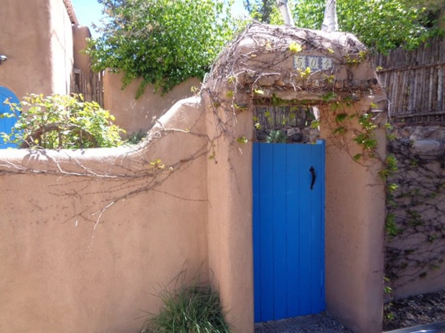 Hello! The proverbial Santa Fe blue gate greets your arrival.