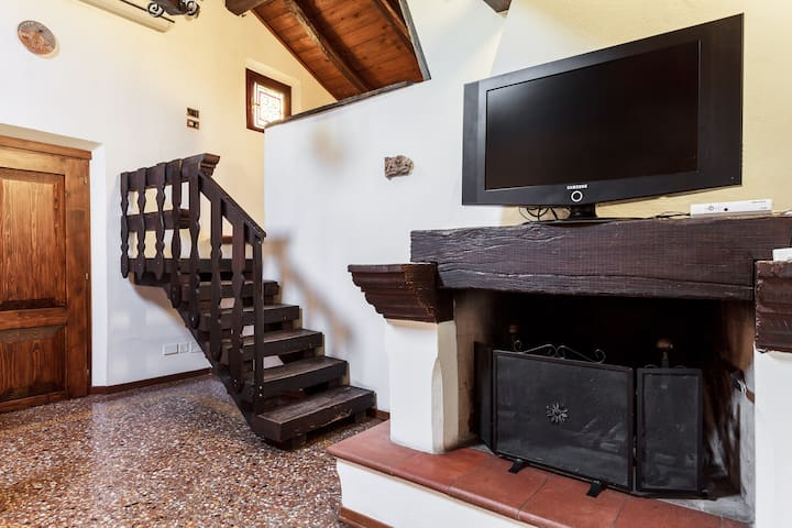 Stairs to the first bedroom with bathroom