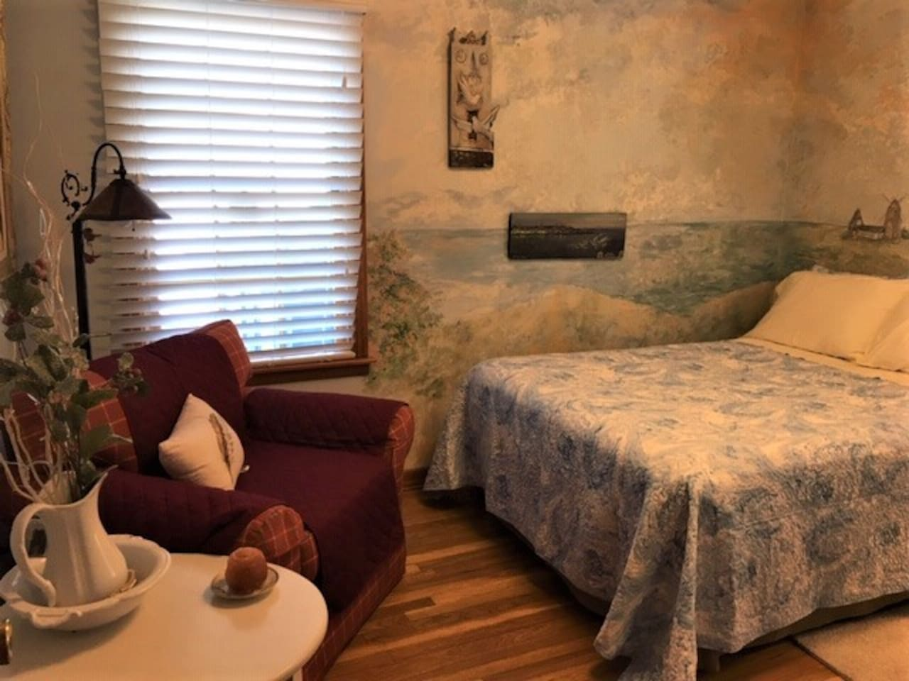 The Hideaway is a cozy room with sea shore decor and a view of Mt. Greylock out the window. A comfy double bed to one side, a grand chair in the corner for reading and a desk for your use. The Hideaway is one step from a shared roomy bathroom.