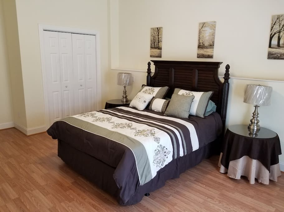 Large bedroom with queen size bed and large closet.