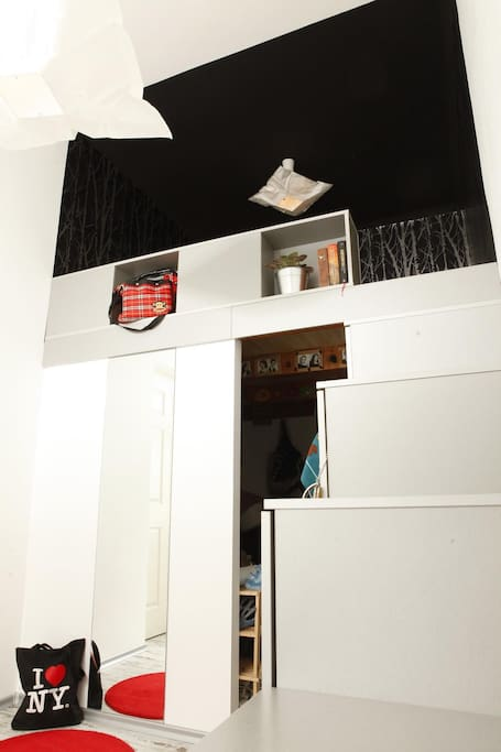 Downstrairs - wardrobe; upstairs - double bed; stairs functioning as closet