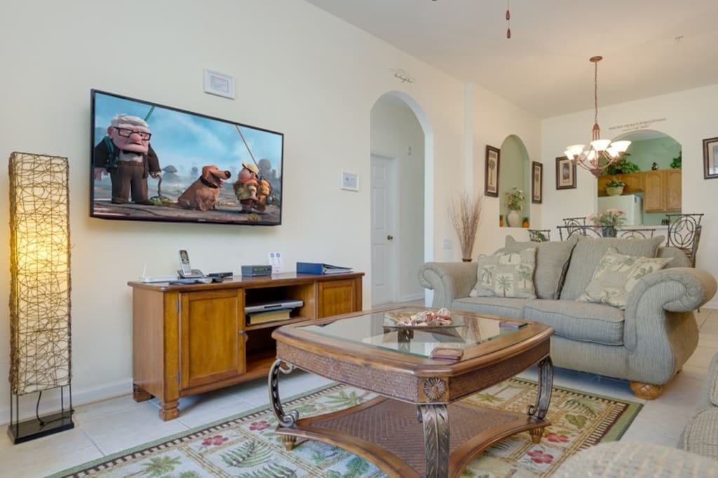 Kick back in style with comfortable sofas and large flatscreen TV
