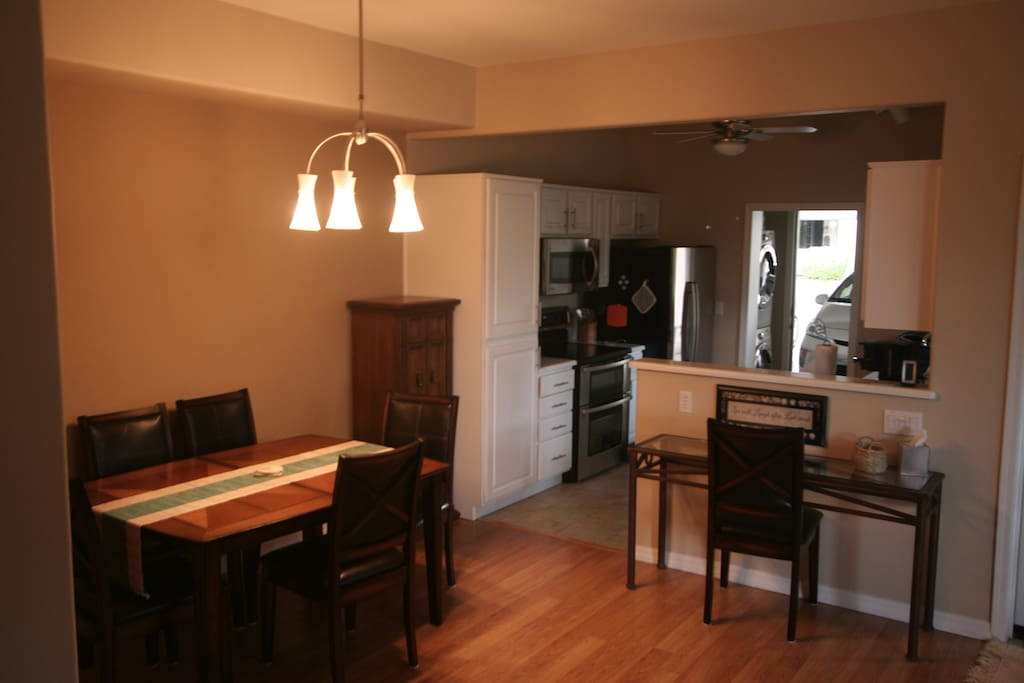 Dining area and kitchen.  Door to garage.