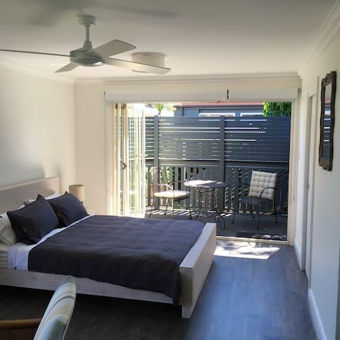 Bi fold doors open onto sunny deck