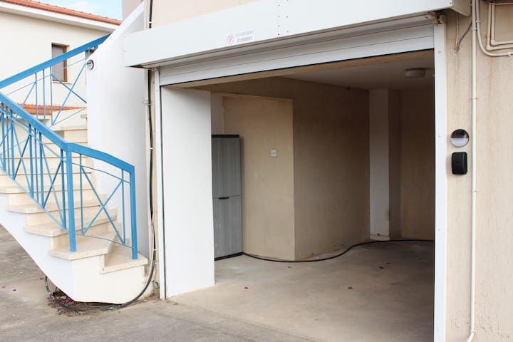 Entrance is through the apartment's own garage which secures with an electric sliding door. The key is in the black box with code combination seen at the right of the picture.