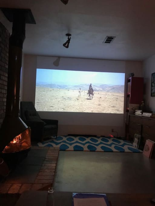 settle in for a cozy night of movie watching by the fire. take note.streaming isn't possible with the projector right now so bring some DVD's or pick one from my collection!