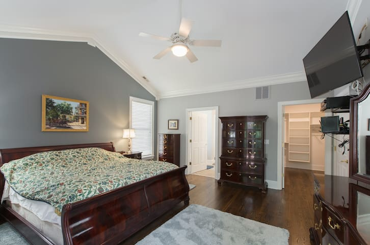 Master bedroom upstairs with Thomasville furniture, tempurpedic king bed and huge walk-in closet with closet system