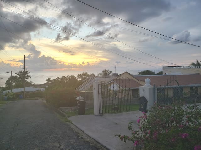 Front Black Gate with sunset ocean view in the background