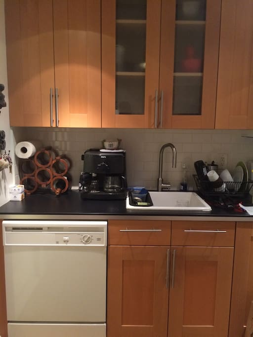 Brand new kitchen with dish washer, new coffee maker, electric stove.