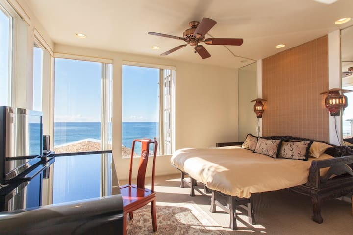 Guest House Bedroom sleep 2 more with ocean views, flat-screen TV, desk and private shower bath