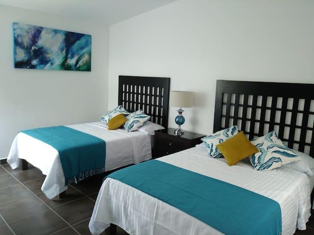 Habitación 1.-  Dos camas matrimoniales