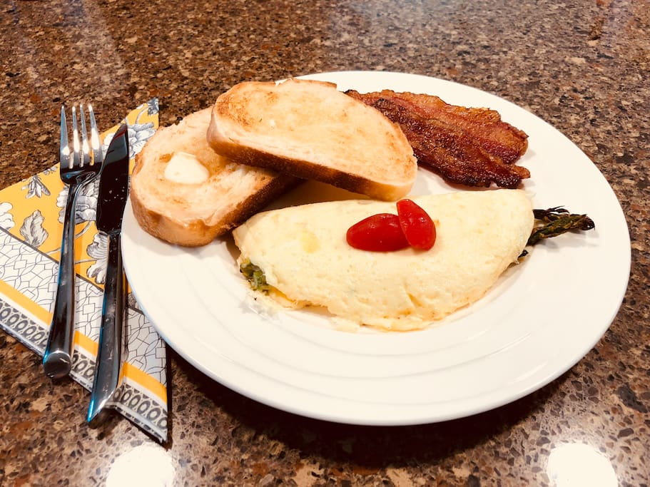 Asparagus and bocconcini omelet with potato bread toast and Applewood bacon!