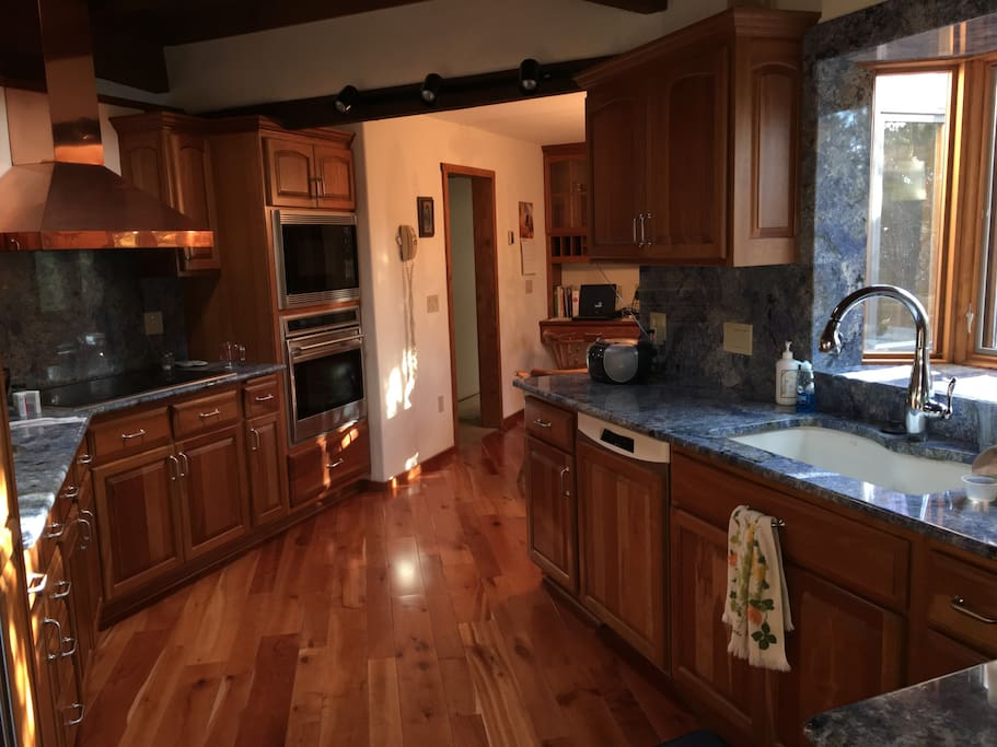 Beautiful Kitchen w/ Blue Granite Counter-tops, Wolf built in Ovens & Cook-top - Sub-Zero Refrig.