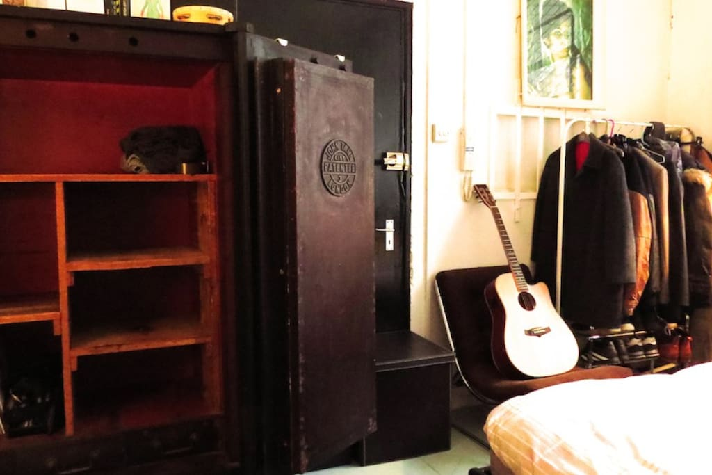 Storage includes clothes rail and a 19th century safe.