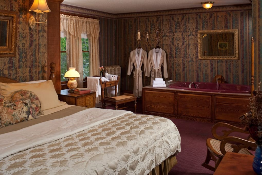 A king bed, luxurious whirlpool and soft robes await