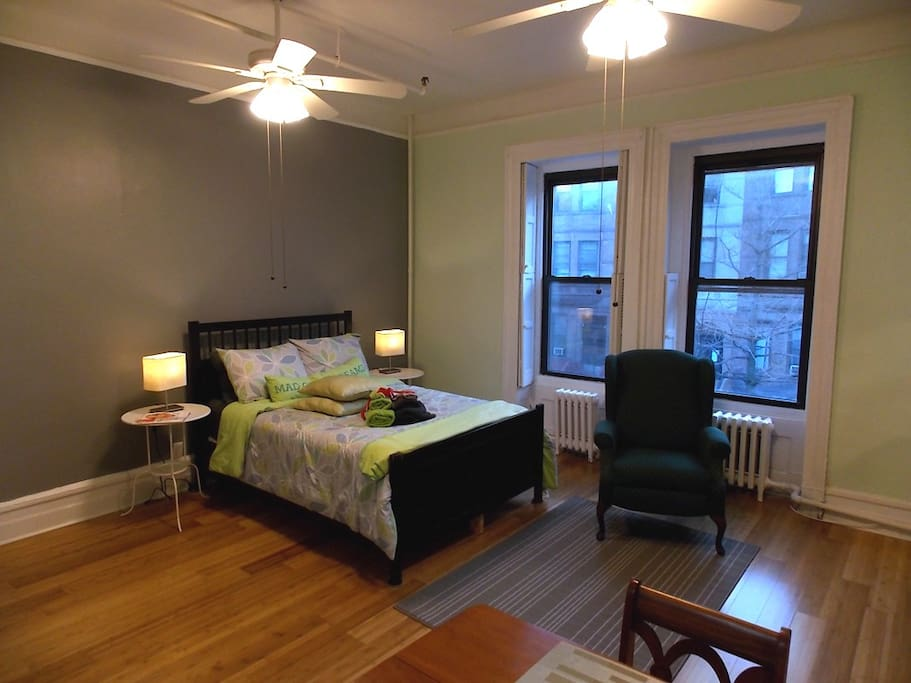 This room faces our charming brownstone lined street.