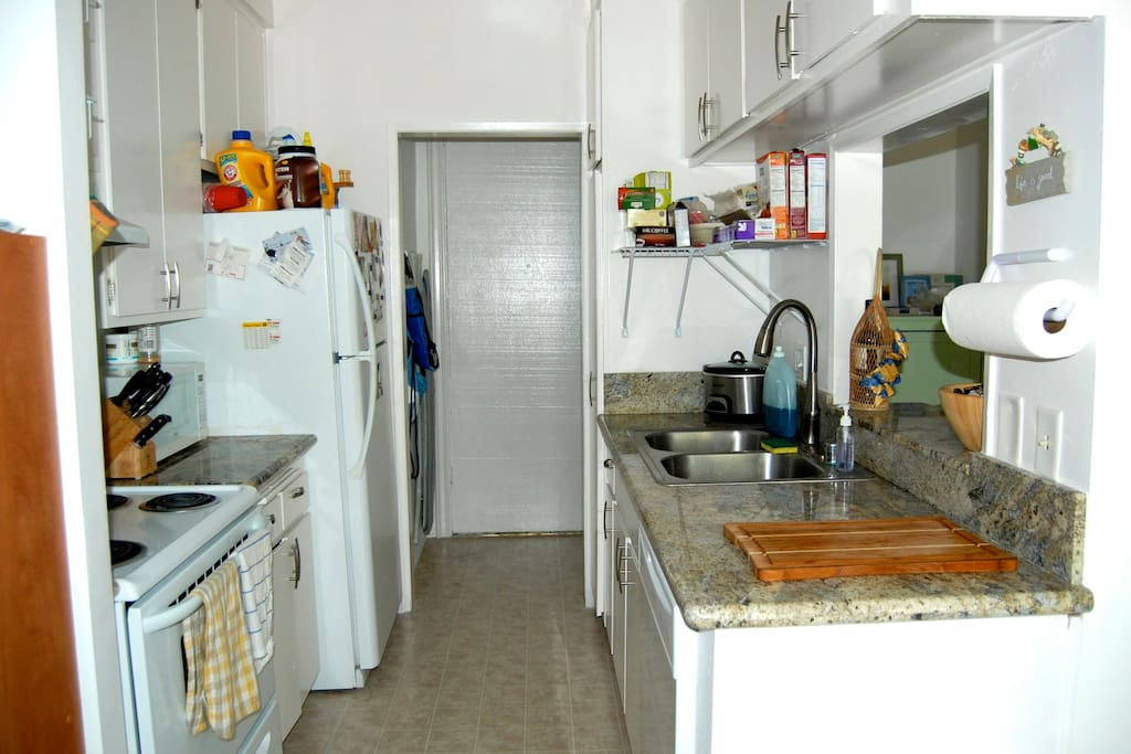 Full kitchen with dishwasher, oven, food disposal + microwave.