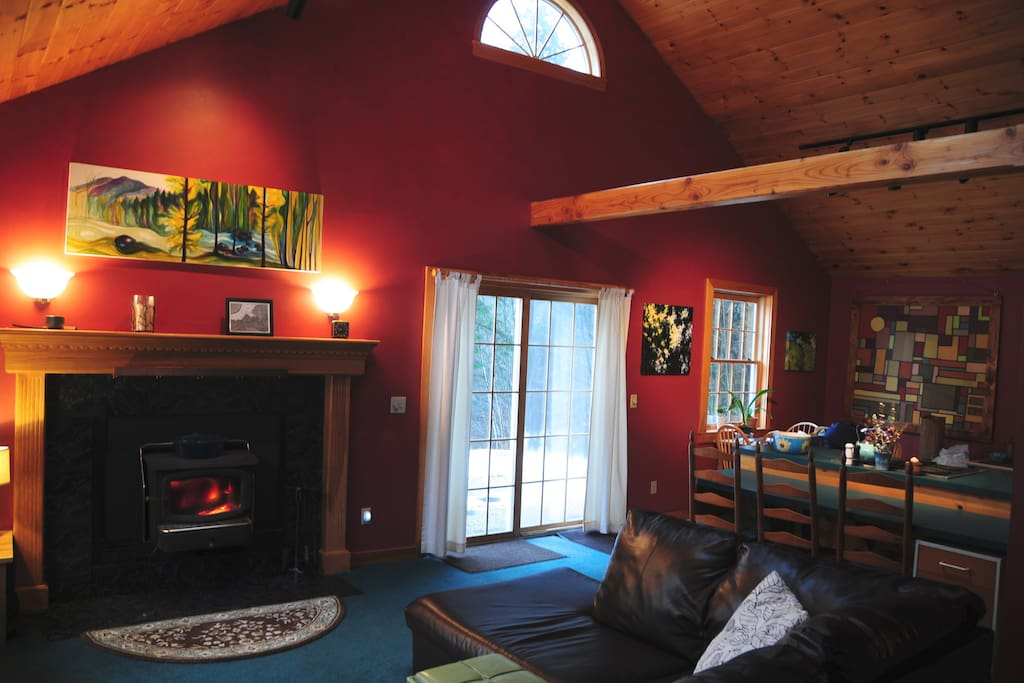 Living Room. Stoke a fire and sprawl out while reading, listening to music on the Bose SoundDock, or watch a movie on Netflix after a long day of northern Vermont adventures.