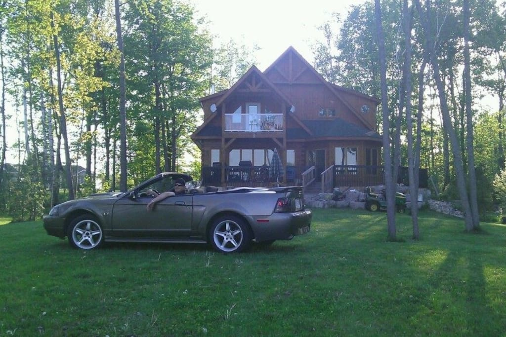 Our son could not help taking a picture of his Mustang...parked on the back lawn of the cottage.