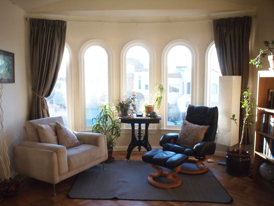 The living room has large windows facing west. We get beautiful sunsets and on clear days can see the ocean.