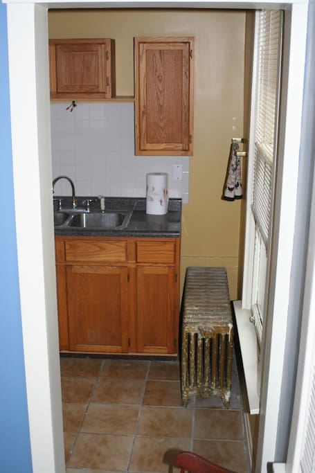 Full kitchen with stove, refrigerator and amenities.