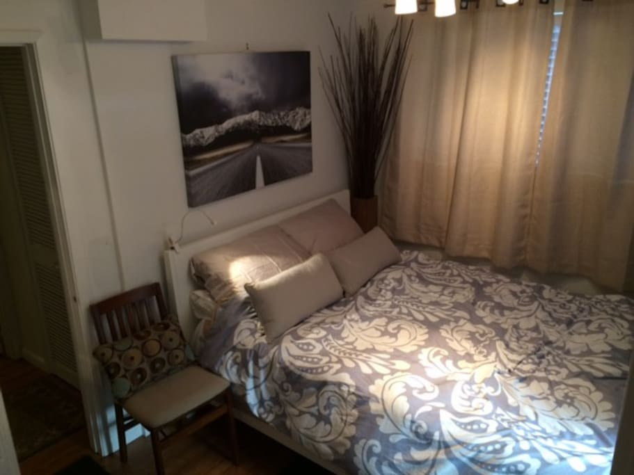 New Queen Tempurpedic bed with clean sheets, duvet cover and blankets.
