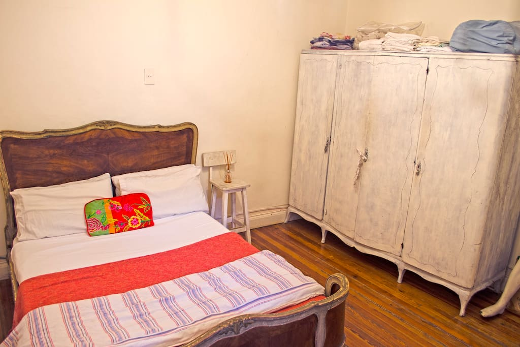 Comfortable double bedroom, for single or couple. with antique bed and placard.