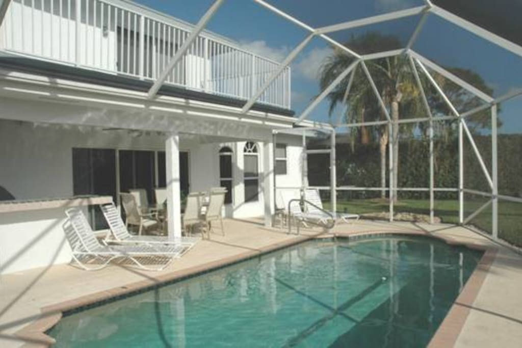Private pool and patio with a screened lanai