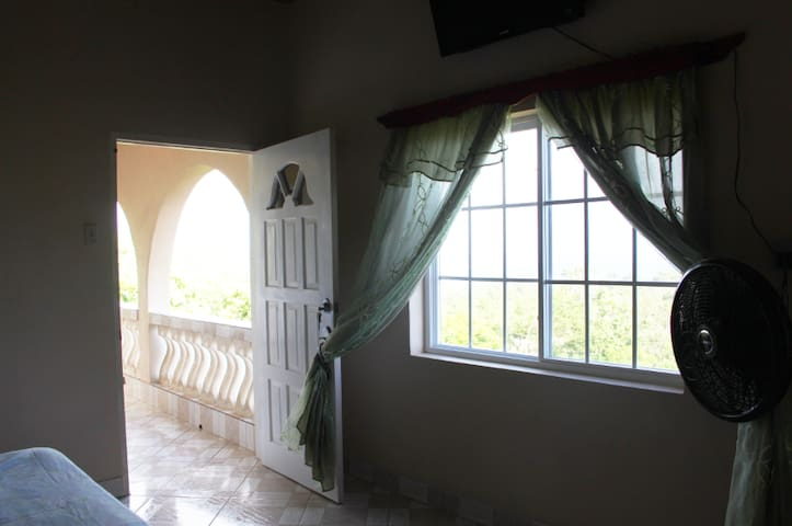 Marline Sunshine has a private entrance and opens right up to the veranda also air condition.
