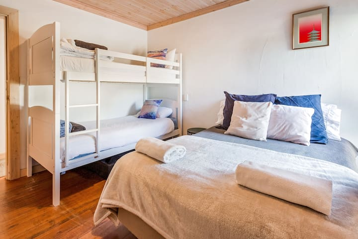 The third bedroom with Double bed and single bunks.