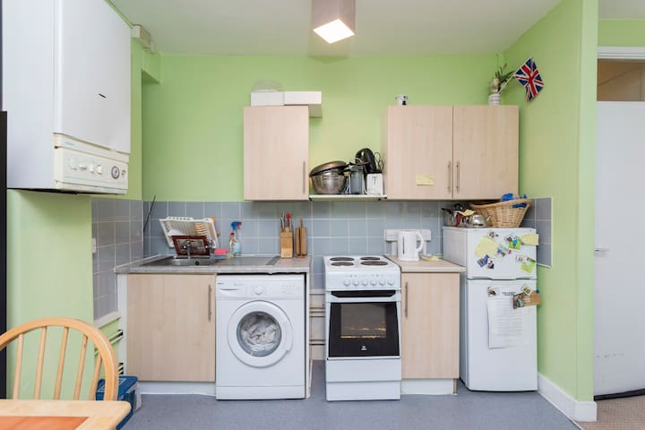 Clean warm and aceesible kitchen. all utiliies working well nad in clean conditions. Guests can use any items freely in the kitchen, and feel at home. Any food in there is for guests, if they would like to.