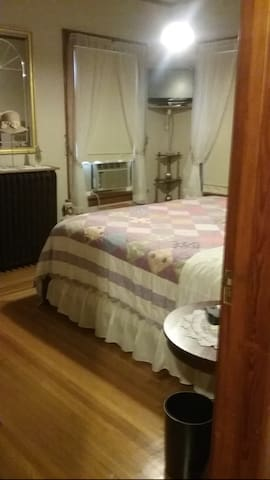 Lower level 1st. Bedroom with queen bed and TV