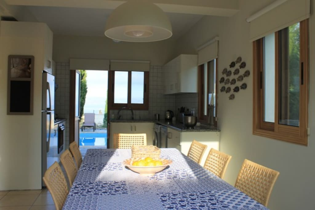 Dining room to Kitchen with views out to the sea