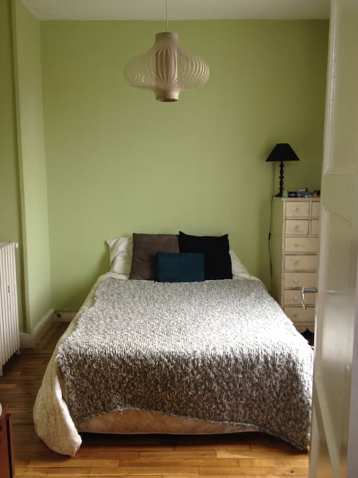 1st Bedroom with two dressers and large closet, overlooks garden