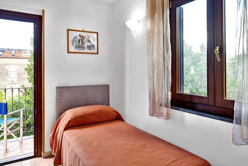 The single bedroom is accessed via the living room, and is most pleasant, bright with a window and small balcony.