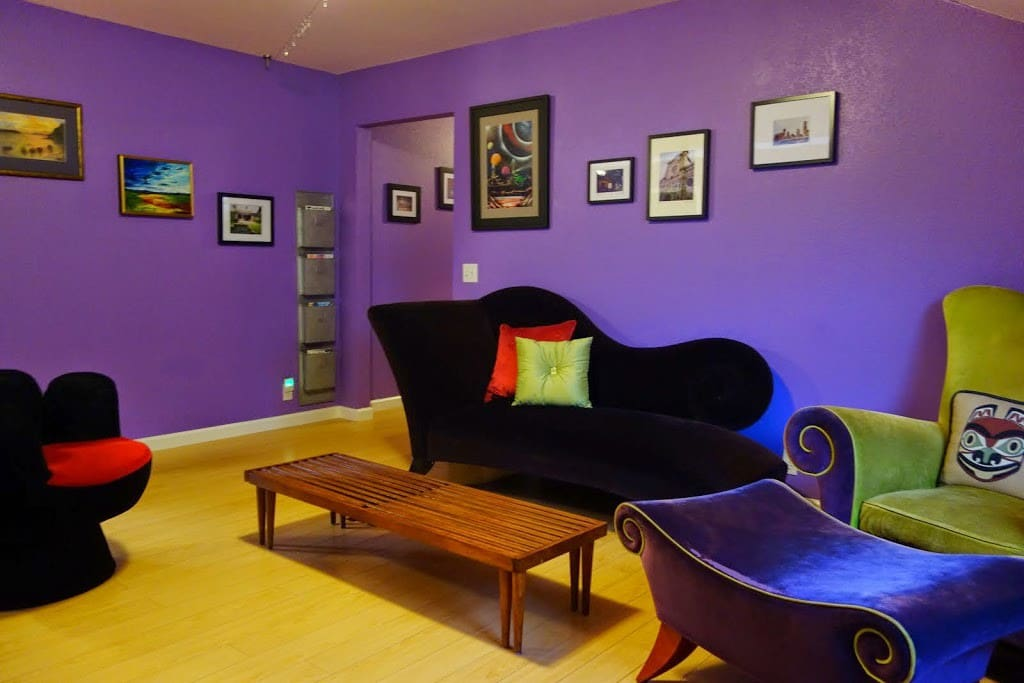 Upstairs lounge with a large TV for additional movie viewing.