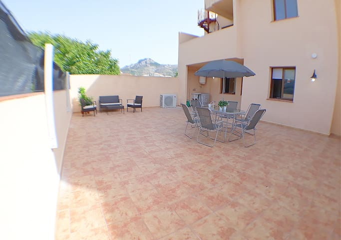 Rear patio, plenty of sunshine throughout the day. Sun loungers also provided.